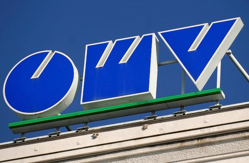 epa04203787 (FILE) A file picture dated 06 March 2007 shows Austrian energy company OMV's logo at the company's headquarters in Vienna. Austrian oil and gas group OMV said 13 May 2014 that its net profit dropped 62 per cent to 301 million euros (414 million dollars) in the first quarter, owing to rising production costs. Unrest in Libya has stopped OMV's oil production in the country since March, while more oil was pumped in Norway, OMV said. This shift pushed up overall production costs and hurt operating profits, which decreased 46 per cent year-on-year, to 675 million euros. Revenues fell 9 per cent to 9.83 billion euros in the quarter that was marked by lower oil prices. In addition, the mild winter reduced demand for gas from OMV, which is active in several Central and Eastern European markets.  EPA/ROBERT JAEGER *** Local Caption *** 02597231